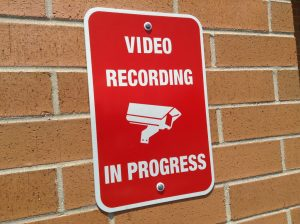 "Sign that reads ""video recording in progress"""