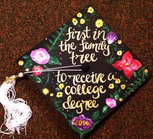 "graduation cap that says ""first in the family to receive a college degree."""